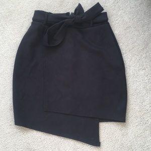 Gorgeous asymmetric skirt. Tie belt at waist,